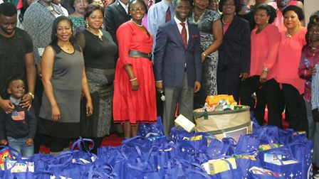 Embassy of faith members with the donated food at the same event last year.