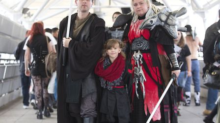 Cosplayers attend the MCM Comic Con at the Excel London.