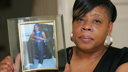 Cheryl Evans, with a picture of her murdered son, Warren