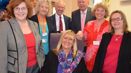 Jane Sutherland (centre seated) with colleagues. From left to right: CEO Pam Court, director of corp