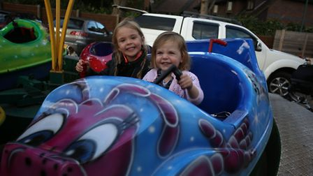Vivienne Speakman, five, and Lola Speakman, two, at Woodford fire station, which hosted a community