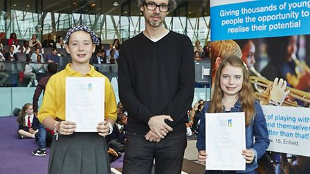 From left to right: Aimee Dart, 9 (left), pianist James Rhodes (centre), and Molly Gulvin, 8 (right)