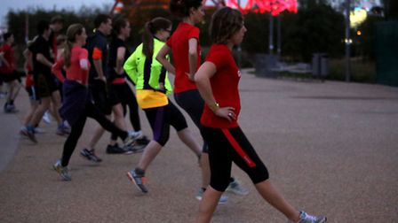 It's still light as joggers warm up for their run by the ArcelorMittal Orbit