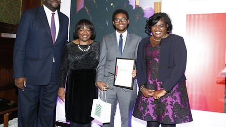 Abubakar Moallim is pictured at the awards with MP Diane Abbott, Darren Allaway from UBS and Maggie