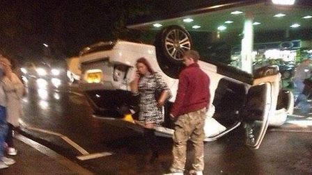 Amy Childs emerges from her vehicle, phone in hand, after Wednesday evening's accident. Photo: Twitt