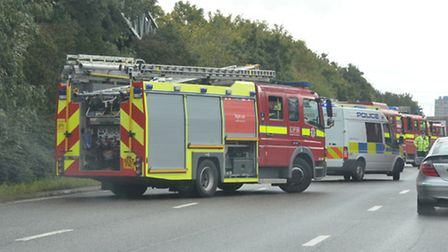 Emergency service vehicles at the A406, where a car overturned. No one was injured. [Picture: Cllr P