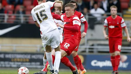 Leyton Orient's Shane Lowry is caught by MK Dons' Mark Randall in the goalless draw at Brisbane Road