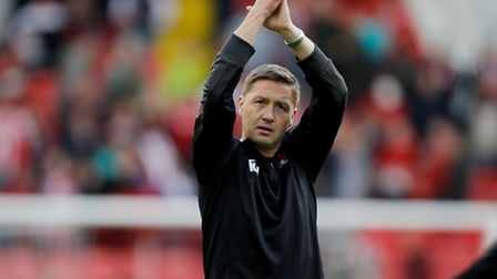 Leyton Orient caretaker manager Kevin Nugent applauds the travelling fans after yesterday's 2-2 draw