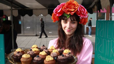 Eli Kennedy, of Paleo Pantry, sells cakes at the vintage fair in The Grove, Stratford Broadway