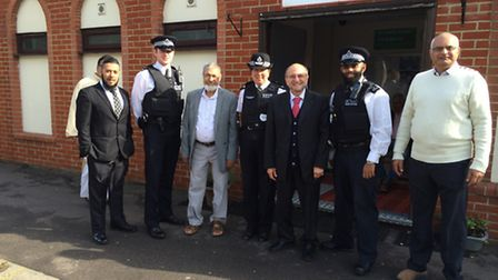 Borough commander Sue Williams and Dr Mohammed Fahim with four police officers at South Woodford Mos
