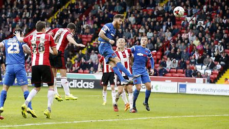 Romain Vincelot rises highest to head home an injury-time equaliser for Leyton Orient at Sheffield U