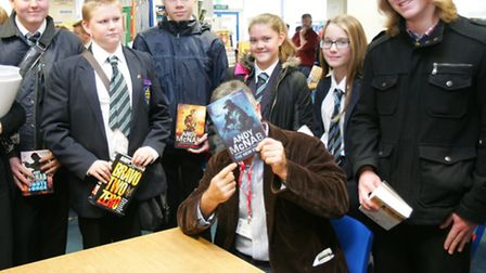 Ex SAS soldier AndyMcNab, who remains anonymous, with students from St Edwards school