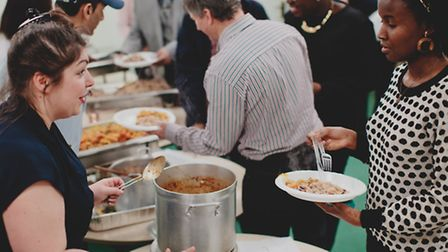 Candice Steen, a volunteer at the night shelter last year, serving food to Carine Vunabandi. [Pictur