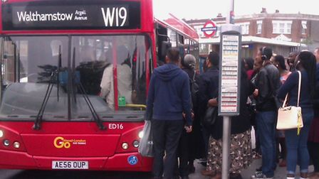 Commuters cram on to the W19 bus