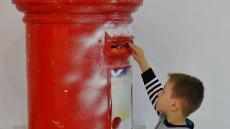 A young boy posts a letter to Father Christmas at Stratford Centre (picture: Donnall O'Fearraig/iWit