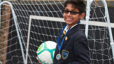 Ten-year-old Jai Makwana shows off his medal in a football competition which promotes British Asians