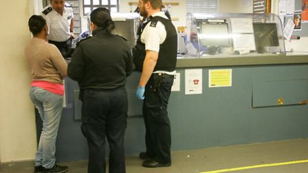 Officers book in an alleged offender