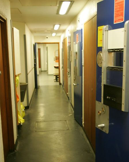 A corridor of cells at Forest Gate police station