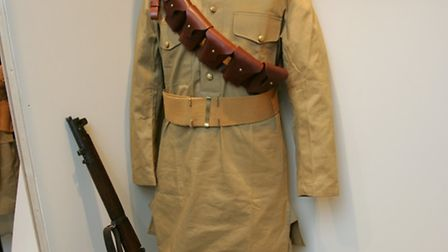 First World War uniform from India on display with a rifle at Redbridge Museum's First World War exh