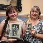 Denise Groves and her daughter LeAnne Arnold, 14, holding pictures of Denise's mother Patricia and f