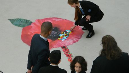 Students added a series of values to the template of the eight-foot poppy at the heart of their scho