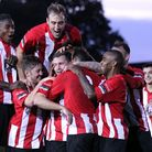 Hornchurch players celebrate after Billy Coyne's goal sealed their FA Trophy win over Harrow (pic: G