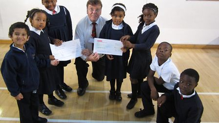 David Spurdle, director of Standbyme, was presented with cheques by some of the children at St Luke'