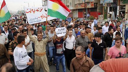 Kurds protest in Kirkuk, northern Iraq, in support of the city of Kobane Photo: PA
