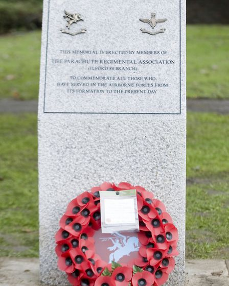 Members of the Ilford 84 branch of the Parachute Regimental Association with their memorial in Coron