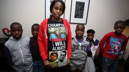 Peguy Kato with sons Bernoulli, 16, Prince, 10 and triplets Kenan, Aanon and Nathan, nine (Picture: