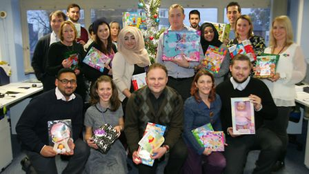 Newham Partnership Working staff with their gifts for the Toy Appeal