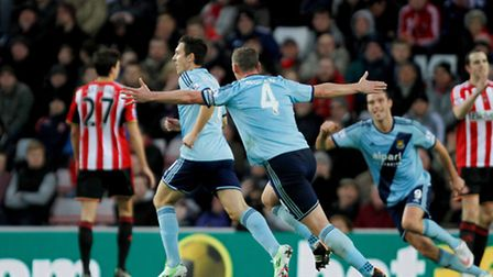 West Ham United's Stewart Downing (left) celebrates his equaliser with team mates during the Barclay
