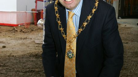 Redbridge mayor Cllr Ashley Kissin with the first brick to be laid on the new school