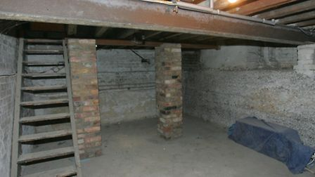 The cellar in Betty's old house where she cowered as a child