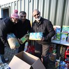 Volunteers packed up the donated food at the Gardens of Peace Cemetery in Hainault (from Right to