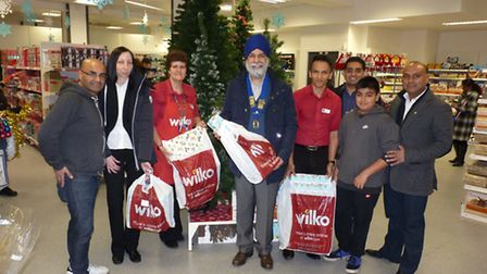 Hardev Sembhi (centre) and Bob Jandoo (right) with fellow Lions and Wilko staff. Picture: Lions Club