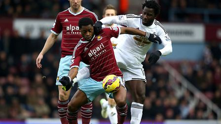 West Ham United's Alex Song and Swansea City's Wilfried Bony battles for possession of the ball