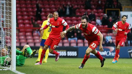 O's Chris Dagnall celebrates his first goal in the 4-1 win over Crawley Town on Boxing Day. Pic: Sim