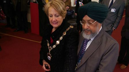 Havering mayor Cllr Linda Trew with Havering CCG's Dr Gurdev Saini, cutting a cake at the relaunch