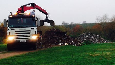 Clearing up the 50 tonne fly-tip in Bonnetts Wood, Upminster. Picture: Clare Rowley