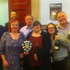 The winning team, Newham Blips, with the trophy and their bottles of wine