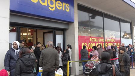 Huge sale at Bodgers, in Ilford, people queuing around the building