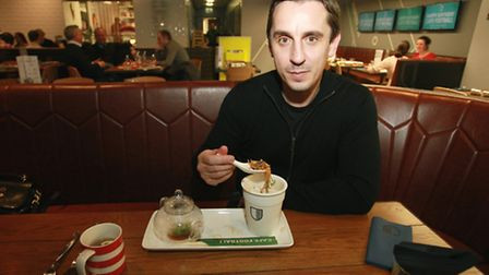 Gary Neville tastes one of the restaurant's dishes