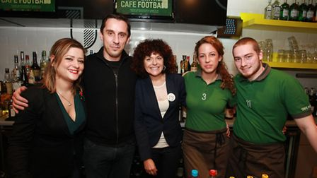 Cafe Football founder Gary Neville, second left, celebrates the first anniversary with staff Valeria