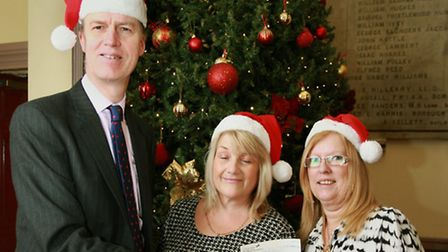 Stephen Timms MP delivers a cheque to Jackie South, right, and Jane Underdown for the Community Lin