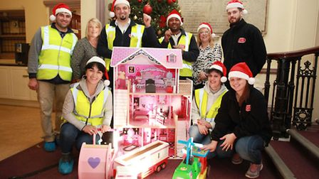 Staff members from Builders Sisk Constractors donate hand-made wooden toys to the Community Links to