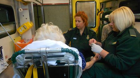 A woman is treated in the ambulance.