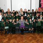 Headteacher Carel Buxton (centre) with pupils and teaching staff.