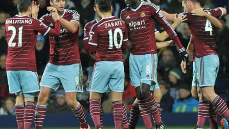 West Ham United's Kevin Nolan (right) celebrates scoring his side's first goal at The Hawthorns