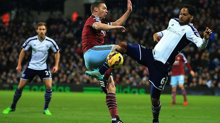West Bromwich Albion's Joleon Lescott battles for the ball with West Ham United's Kevin Nolan during